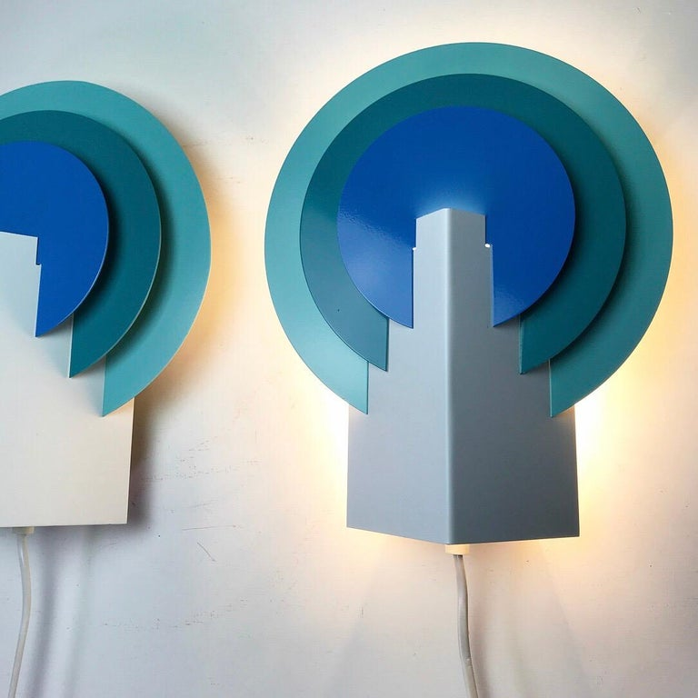 Almost like Mephis styled wall sconces this beautiful set by Lyskaer of Denmark 1970s will certainly bright up your interior - whether they are lit or not.   Three colored wall light has a cool Scandinavian design and the color shades of blue and