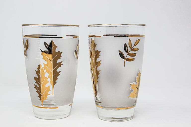 Set of two vintage cocktail glasses. Manufactured by Libbey. 1950s Hollywood Regency. Decorated with a classical gold lief pattern on frosted glass. In good condition, perfect for the holidays and gorgeous on display in a cabinet or bar while not