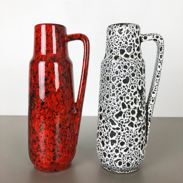 Article:  Set of two Fat Lava art vases   Producer:  Scheurich, Germany   Design:  Nr. 275 28    Decade:  1970s   Description:  This original vintage Vase was produced in the 1970s in Germany. It is made of porcelain in Fat