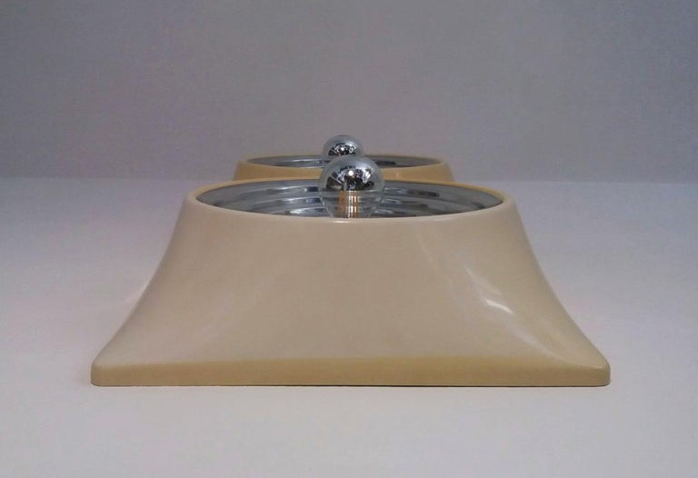 Wall lamps in ABS (Plastic) and aluminum, designed by Nizzoli Associati, Stilnovo Production 1969, Italy. Signed STILNOVO Italy. Lamp out of production.