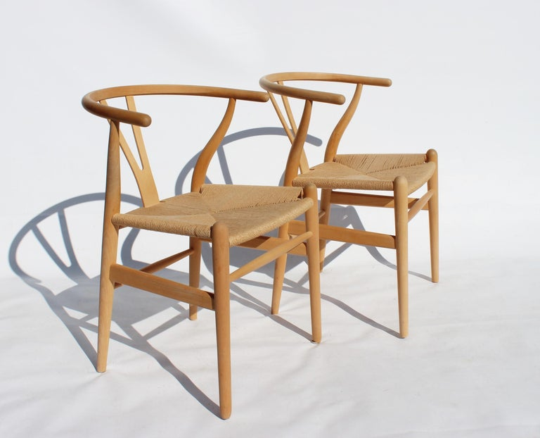Set of two wishbone chairs, model CH24, of beech and papercord designed by Hans J. Wegner and manufactured by Carl Hansen & Son in the 1960s. The chairs are in great vintage condition.