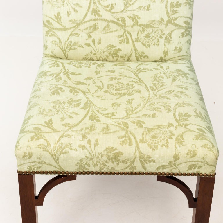 Set of eight dining chairs in custom B.Tyler graphic upholstery with brass nailhead trim and bracketed corners on the legs.