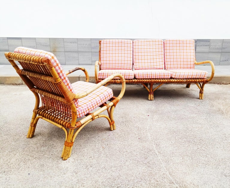 Rare set of armchair and sofa rattan and bamboo by Vittorio Bonacina manufactured in Italy in 1960s. In very good vintage condition, with all its original cushions and fabrics.