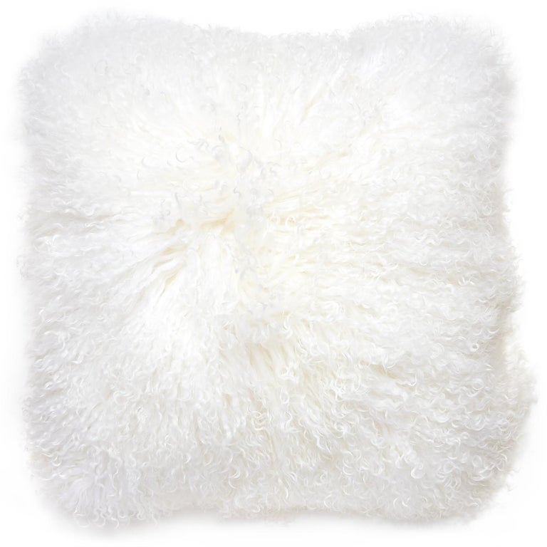 Trippy texture. Made from luxe Mongolian sheep fur, this pair of two pillows will add soft-focus glamour to your sofa or bedscape. Chic up your chalet, perk up your penthouse, or stylize your studio.  Specs: 100% Mongolian lamb hair face 100%