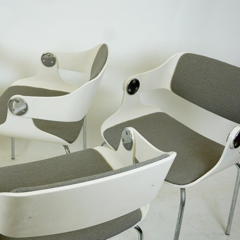 This iconic side chairs from Germany 1960s were designed by Eugen Schmidt for Soloform. They feature chromed steel legs and white lacquered bent plywood seats with newly upholstered grey seats and backs. The chairs are very comfortable and will be