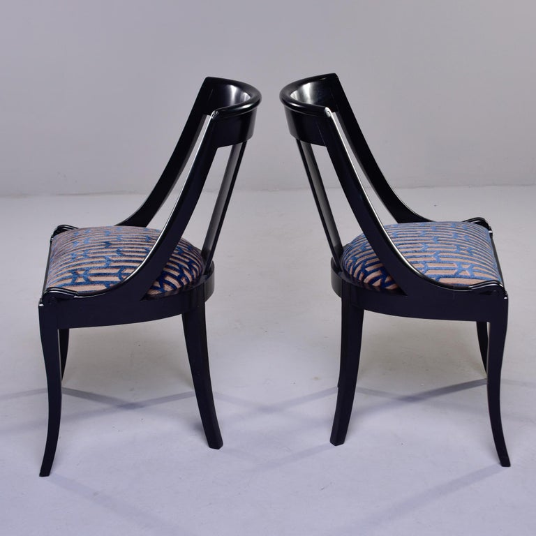 Circa 1900s set of French gondola style dining chairs. Sleek frames have curved back rests and new, professional black finish. Newly upholstered with a chenille velvet in teal and taupe. Unknown maker. Sold and priced as a set of six.   Measures: