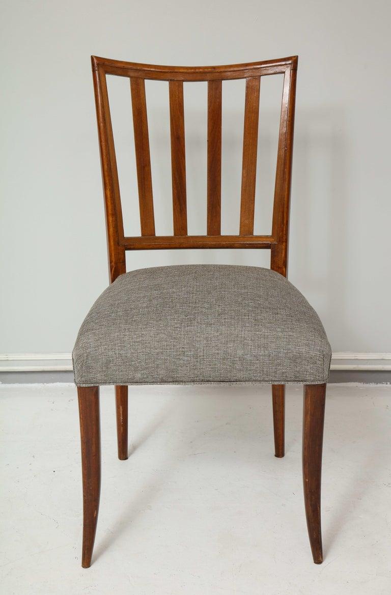 Set six mid-century slat-back dining chairs.