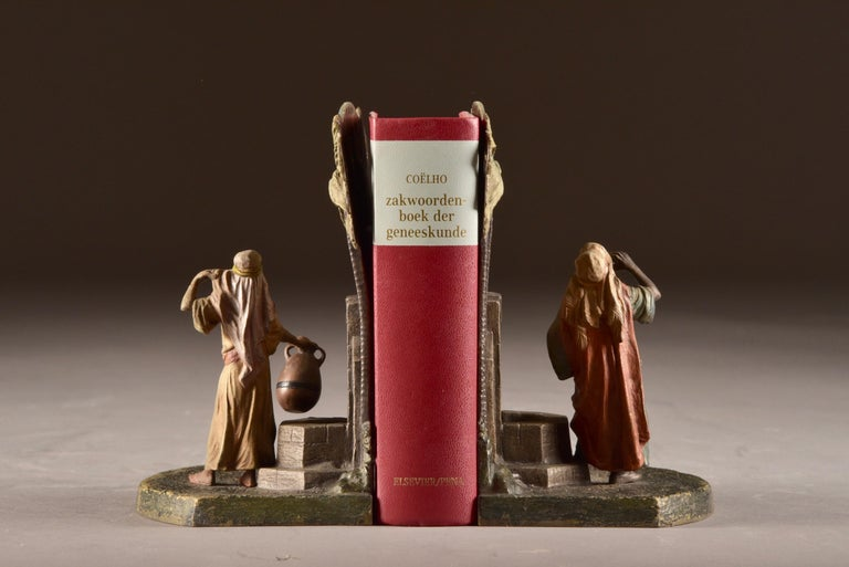 Viennese bronze: set of beautifully executed bookends with an oriental figure at a water source.