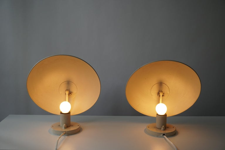 A set of white and pink PH hat wall lamp designed by Poul Henningsen in the late 1970s and manufactured by Louis Poulsen in Denmark. Both labeled with paper-stickers from Louis Poulsen.