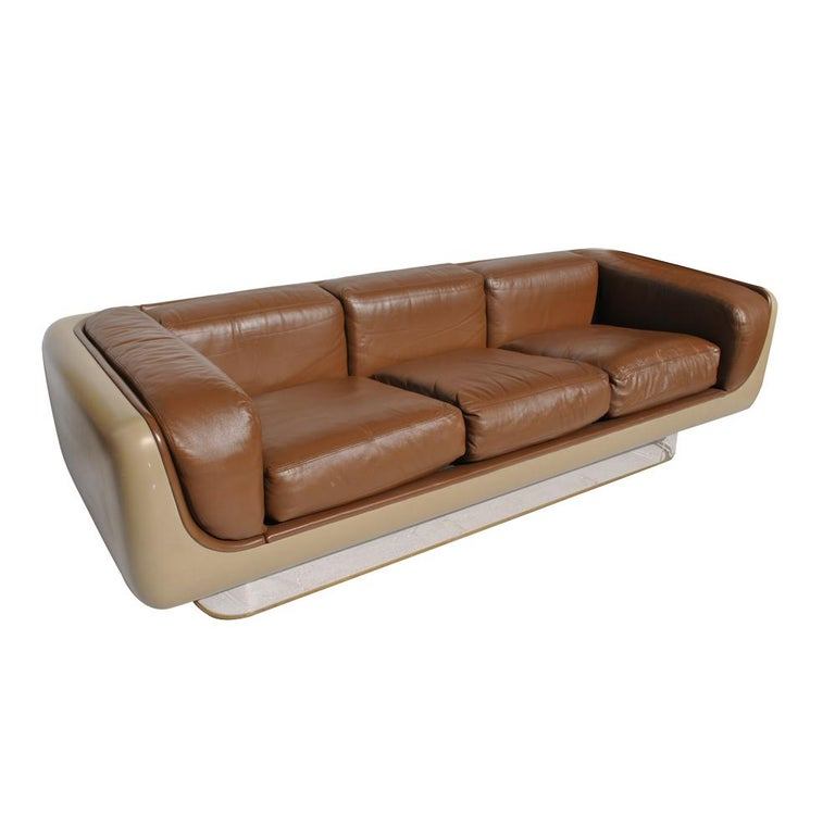 William Andrus for steelcase. Set of steelcase #465 soft seating series.  Classic early 1970s sofa designed by William C. Andrus for Steelcase Soft Seating Group. The cream fiberglass shells appear to float on a Lucite base.  This five-piece set