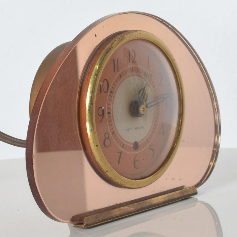 Seth Thomas Sequin Art Deco pink copper mirror electric table clock glamourous Old Hollywood circa 1940s  Pretty pink peachy mirrored case with a copper face and black numerals. Fabulous look!  Dimensions: 4 3/4