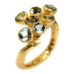 Seven Aquamarine 18 Karat Gold Ring Handmade by Disa Allsopp