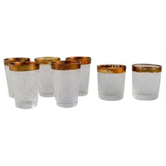 Seven Drinking Glasses in Mouth-Blown Crystal Glass with Gold Edge, 1930's