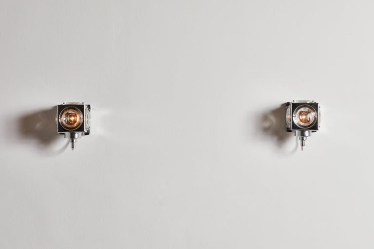 Seven sconces by Oscar Torlasco for Stilkronen. Designed and manufactured in Italy, circa 1970s. Chrome-plated brass, glass, metal. Rewired for U.S. junction boxes. Each light takes one E27 40w maximum bulb. Bulbs provided as a onetime courtesy.
