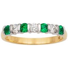 Seven-Stone Diamond and Emerald Ring