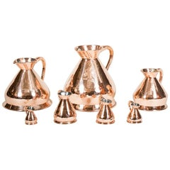 Seven Victorian Copper Standard Measuring Jugs
