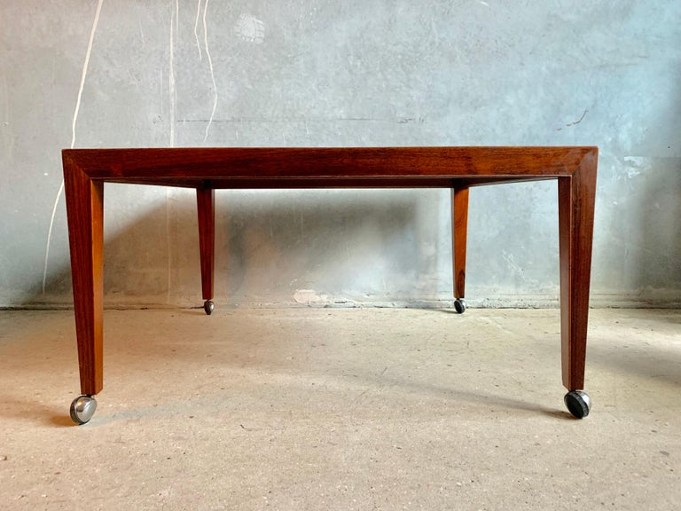 Rare Severin Hansen Jr. coffee table made in rosewood featuring Baca tiles and vintage wheels made of steel.