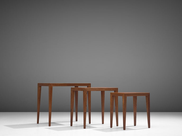 Severin Hansen, nesting tables 'model C-38-6', rosewood, Denmark, 1950s.  These clean, modest and simple nesting tables feature rectangular tops with tapering legs. Very Danish, both in their aesthetics as in their construction. Well-constructed,