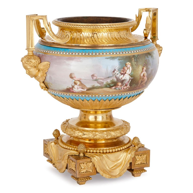 With its delightful painted representations of the four seasons and bacchanalian scenes, this 'bleu celeste' garniture demonstrates the technical excellence of Sevres factory porcelain. On top of this, the porcelain vases are beautifully decorated