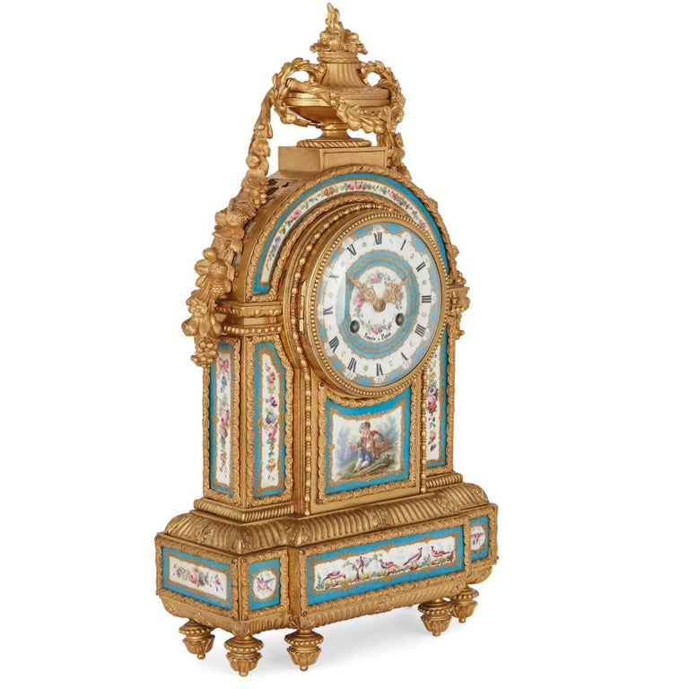 This beautiful mantel clock has been designed in an 18th century Rococo style, which was popularised by the Sèvres Porcelain Manufactory. The clock has been expertly cast in bronze and gilded, then set with intricately-painted porcelain plaques.