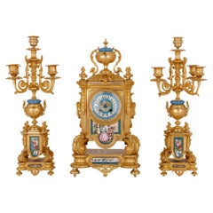 Sèvres Style Porcelain and Gilt Bronze Three-Piece Clock Set