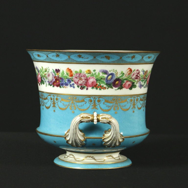 Porcelain vase with two handles, finely all-round decorated with plant and pure gold patterns. Manufacturing brand under the base.