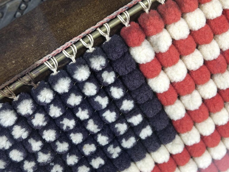 This is an early Folk Art flag made with red, white and blue cotton balls. The condition is beautiful. This is a very unique item from an old Connecticut collection.
