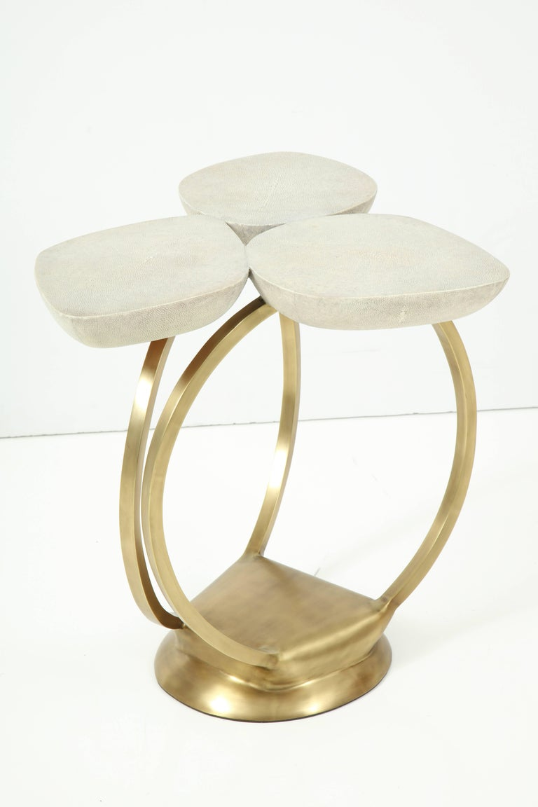 Decorative shagreen and bronze side table. Beautiful flower design. We have the table in the showroom.