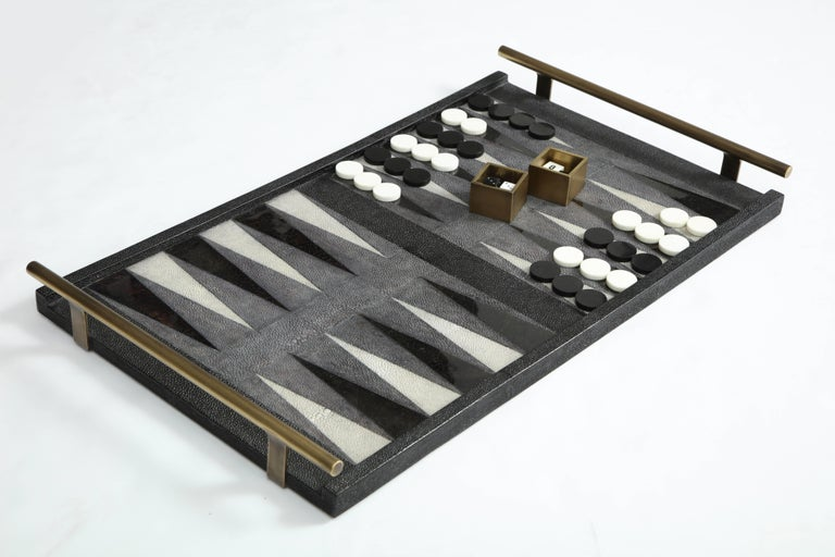 Decorative shagreen backgammon game with black sea shell details and bronze handles.