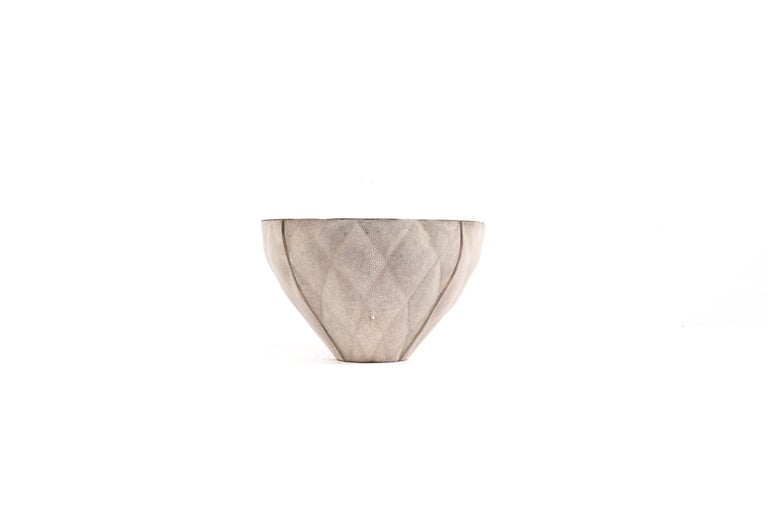The Coco bowl is a sophisticated and luxurious accent piece with its exquisite quilted details. The exterior is inlaid in cream shagreen and the interior in bronze-patina brass. This listing is for the medium size, available in a small size and