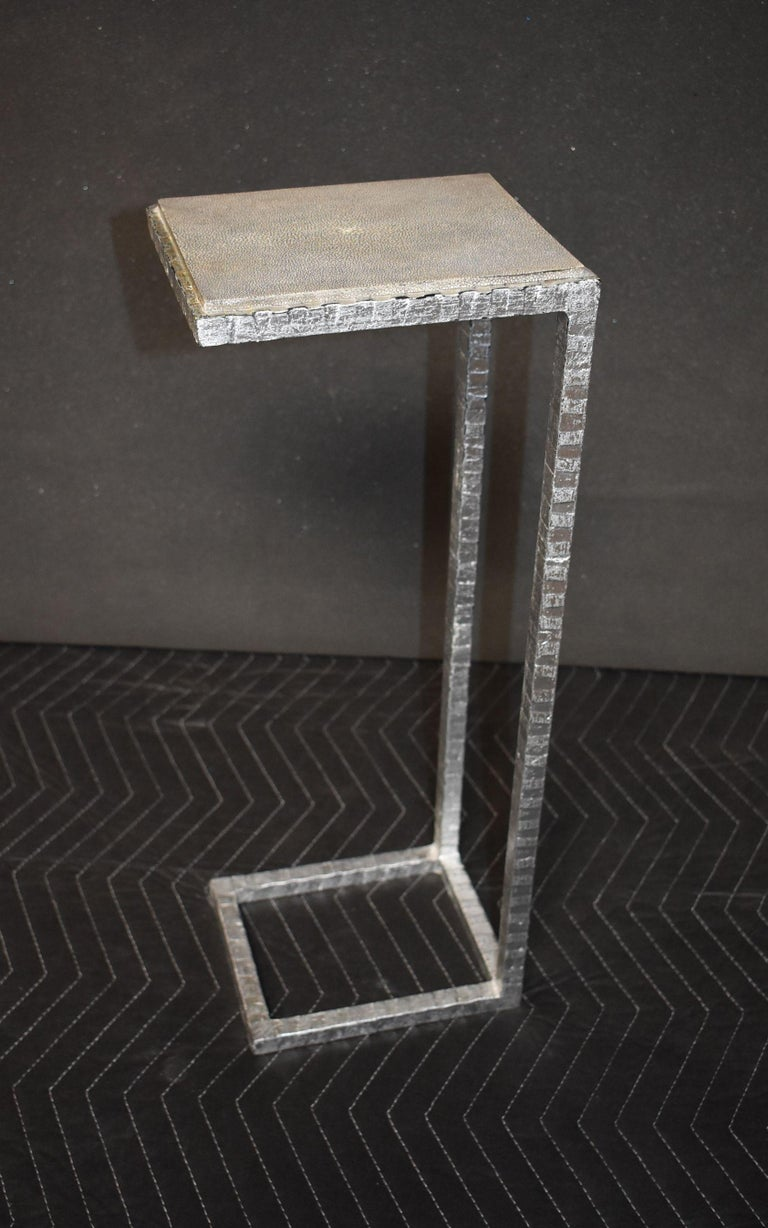 Single gray shagreen top side table with painted silver on metal base.