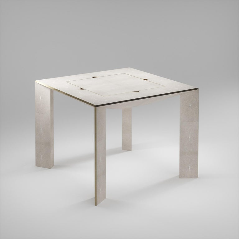 The 4 in 1 Parsons game table R&Y Augousti is a truly luxurious statement piece for your home. The clean lines of the overall piece in cream shagreen, accentuated by the sleek bronze-patina brass details on the legs make it versatile for any space.