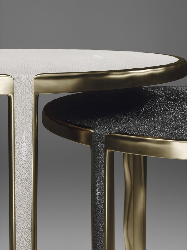 Theset of 2 round melting nesting side tables, are the perfect accent pieces for any living space. These are sold as a set of 2 to create elegant and geometric shapes, but one can purchase the tables on their own. The large and medium size are