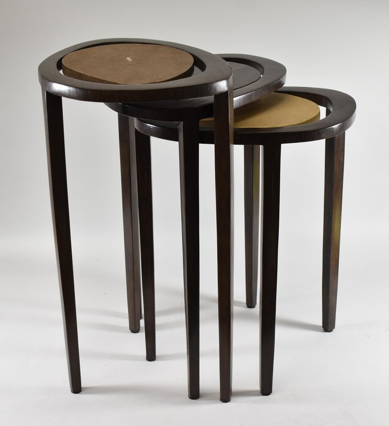 Rosewood and shagreen set of three nesting tables by R&Y Augusti Paris. Free form styled elliptical tops with floating surfaces.