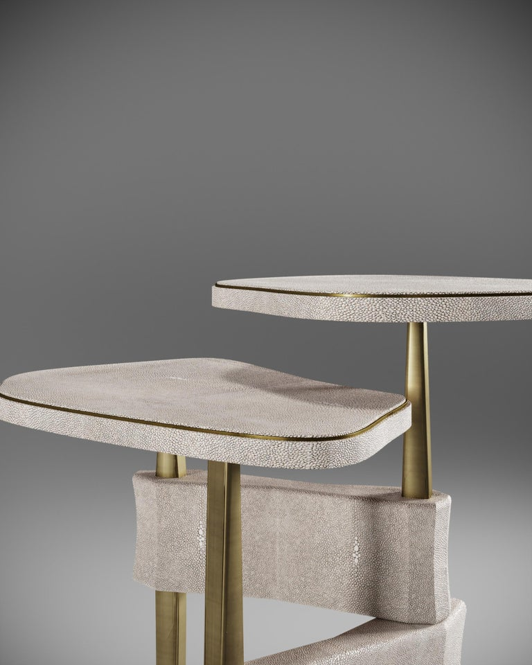 The Metropolis 2-top side table by Kifu Paris is a dramatic and sculptural design that demonstrates the incredible and signature artisanale work from her Augousti genes. The mix inlay Shagreen and bronze-patina brass base of the side table is