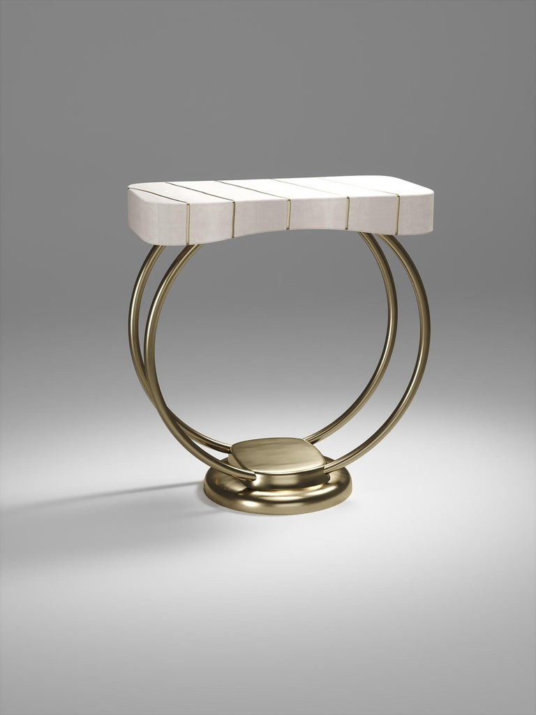 The Melting Ring side table by R&Y Augousti inlaid in cream shagreen is an elegant and sculptural piece for your home. The rectangle top has the iconic melting pattern of Augousti that is slightly in relief from the shagreen surface, and sits on the