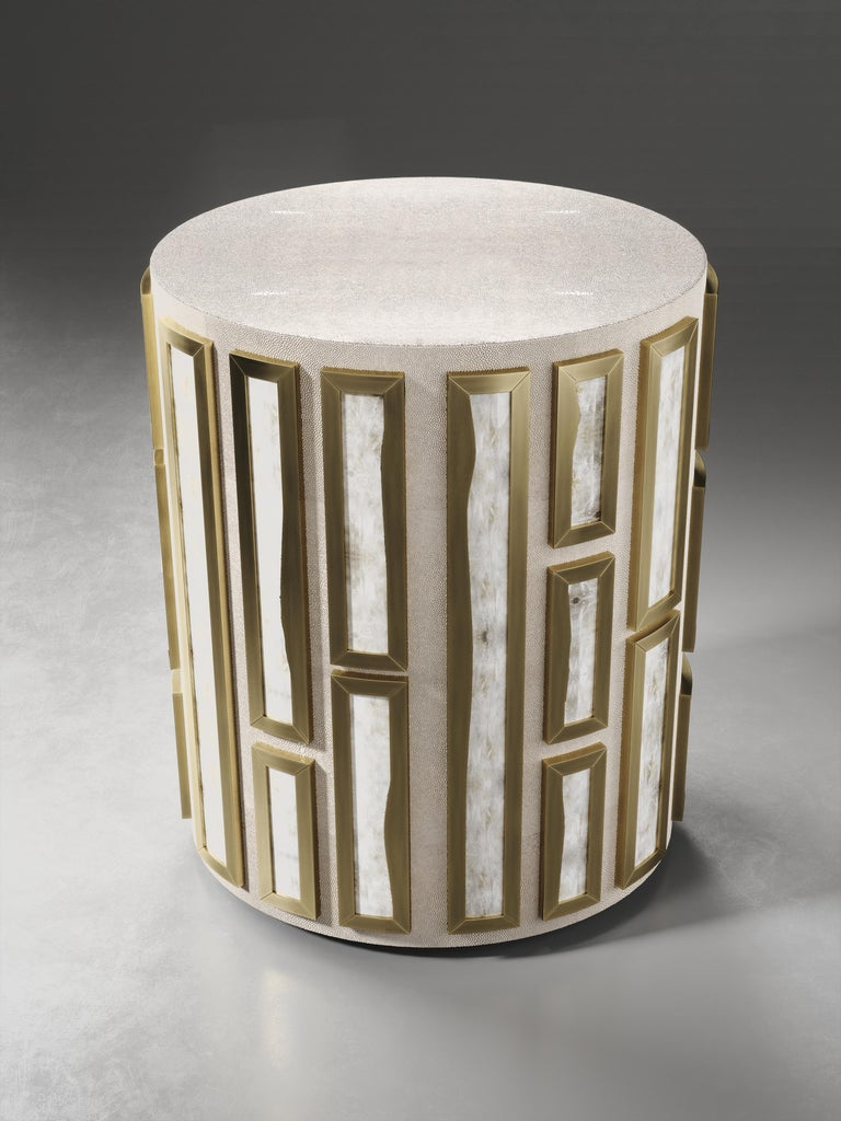The Talisa side table by R&Y Augousti is originally inspired by the jewelry chest version of it (see images at end of slide). This circular piece is a solid structure inlaid in cream shagreen and bejeweled with raised intricate white quartz inserts