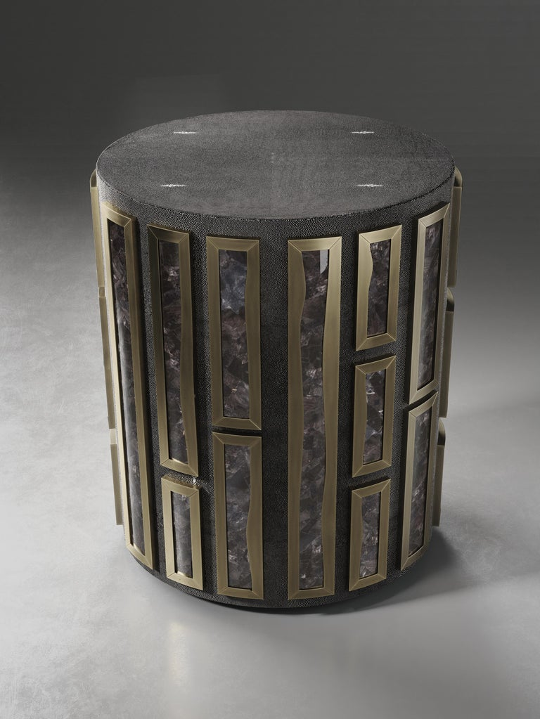 The Talisa side table by R&Y Augousti is originally inspired by the jewelry chest version of it (see images at end of slide). This circular piece is a solid structure inlaid in black shagreen and bejeweled with raised intricate black quartz inserts