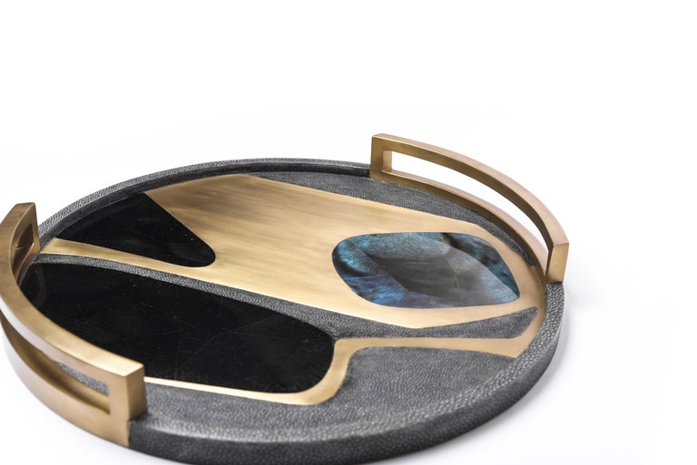 The Cosmos circular tray and matching vases make a stunning tabletop piece for any space. Inlaid in a mixture of shagreen, shell and brass