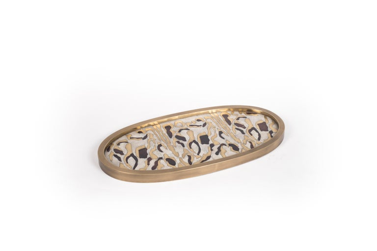 A Classic oval vanity tray revisited; this Kifu Paris leopard pattern tray is inlaid in a mixture of cream shagreen, brown shell, and bronze-patina brass, making for a stunning tabletop piece in any space. The frame is inlaid in bronze-patina brass.