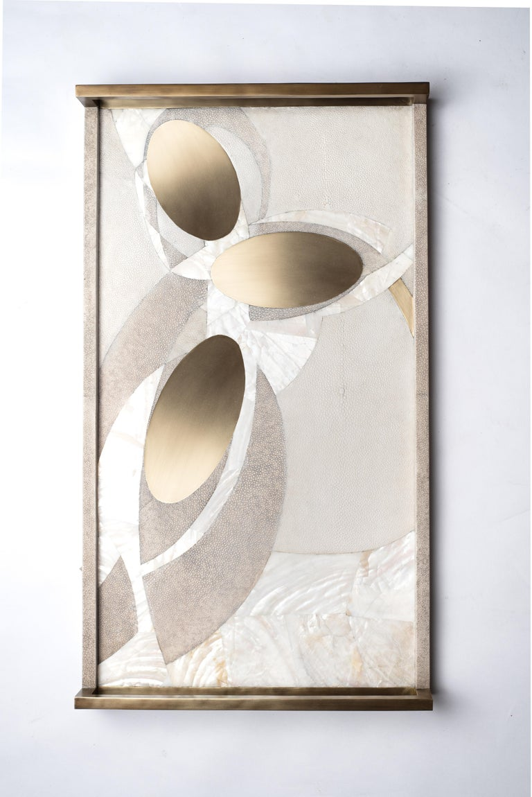 The Lunar light tray in large, demonstrates the beautiful signature Augousti inlay work and design aesthetic. This pattern is an abstract interpretation of lunar constellations. Available in other sizes and color variations as well as pattern