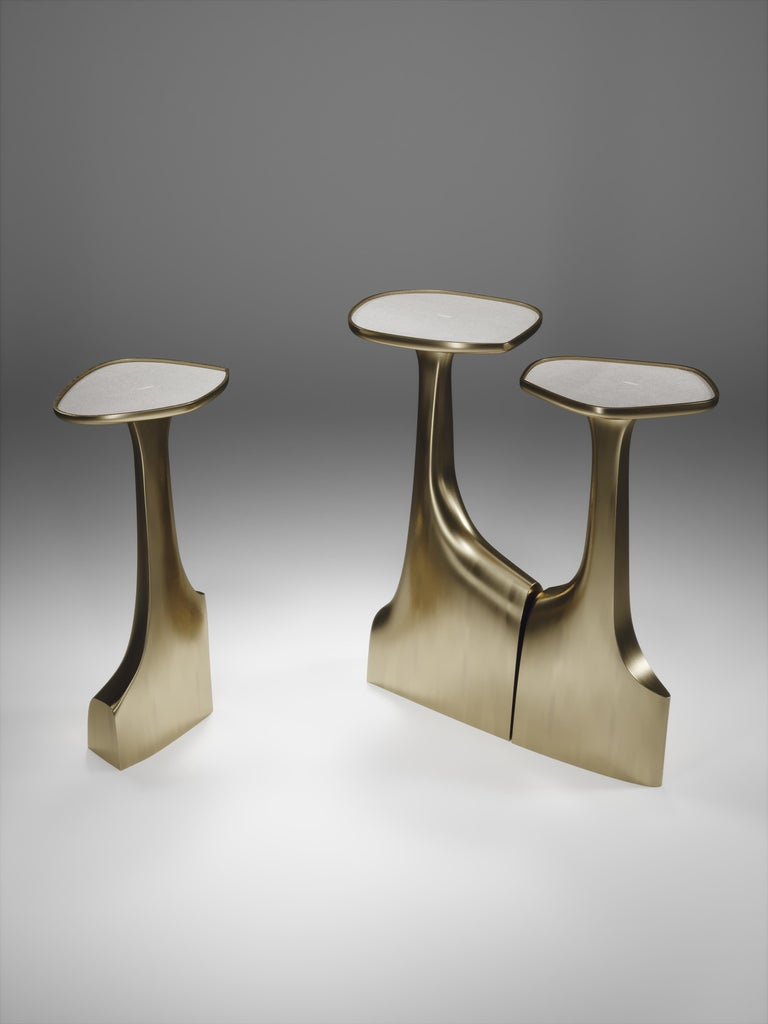 The triptych shagreen side tables by R & Y Augousti are multifaceted sculptural pieces. The beautiful hand craved details on the bronze-patina base can join up to each piece differently to create different compositions for your interior. The tops