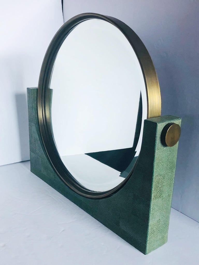 One of a kind Italian vanity mirror with dark green colored shagreen covered base and bronzed hardware, designed by Fabio Bergomi for Fabio Ltd / Made in Italy  Measures: Width 18 inches / height 16.25 inches / depth 2.5 inches. 1 available in Palm