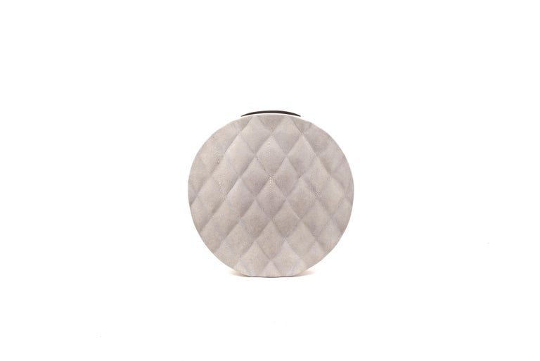 The Coco vase is an elegant piece with it's exquisite quilted detailing. This listing is for the large size inlaid in cream shagreen with bras details on the side frame. All our vases are inlaid with a fibre-glass interior to support water.