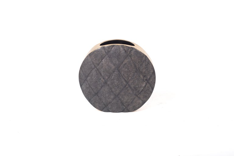The Coco vase is an elegant piece with its exquisite quilted detailing. This listing is for the medium size inlaid in black shagreen with brass details on the side frame. All our vases are inlaid with a fiber-glass interior to support water.  The