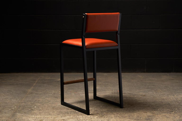 The shaker modern counter stool chair is handmade to order from our unique Ambrozia black textured steel tubing frame and a premium vinyl upholstered seat and back. Leather is available in option. Inspired by the boarding ladder steps of an old