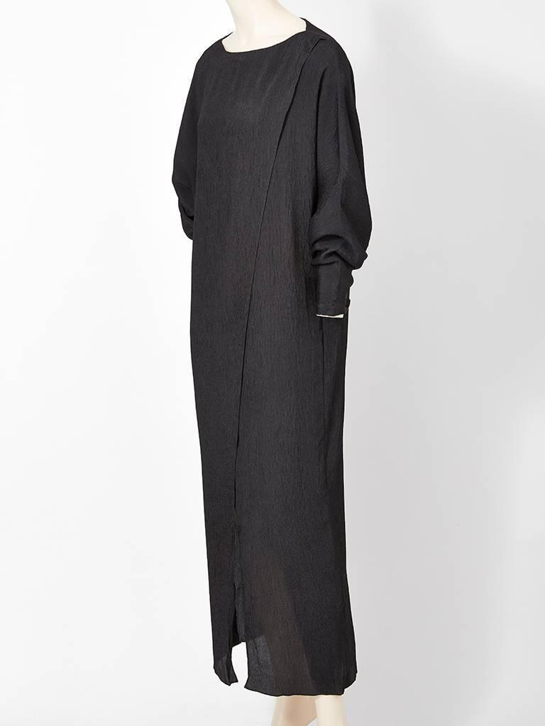 Ronaldus Shamask, black, silk plissé, simple, dolman sleeve, long, sheath, having a boat neckline. C. early 80's.