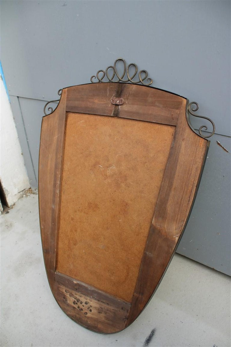 Mid-20th Century Shaped Mirror in Gold Brass with Italian Design Decorations For Sale