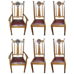 Shapland & Petter, a Set of Six Arts & Crafts Oak Dining Chairs with Two Carvers