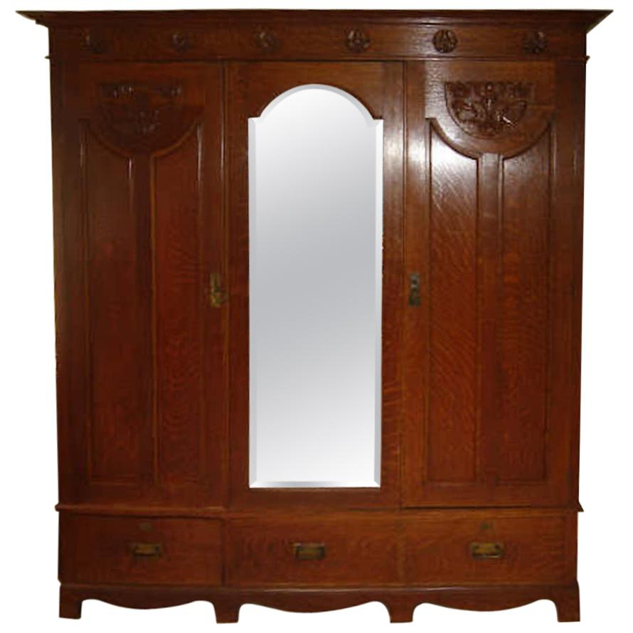 Shapland & Petter, Arts & Crafts Oak Treble Wardrobe with Floral Carved Details